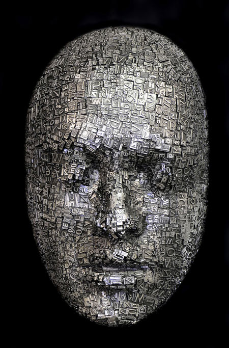 Masks and heads made from moveable type and steel hardware by Dale Dunning