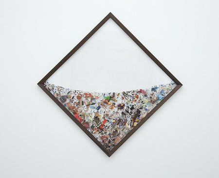 Photographic collages suspended in plexiglas