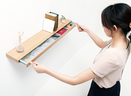 Clopen shelf doubles as a secret drawer