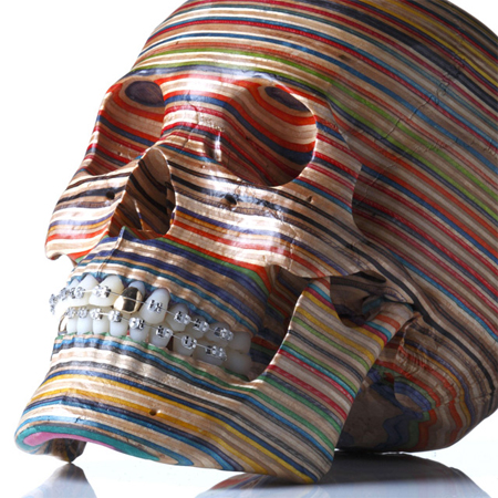 A skull made from repurposed skateboard decks