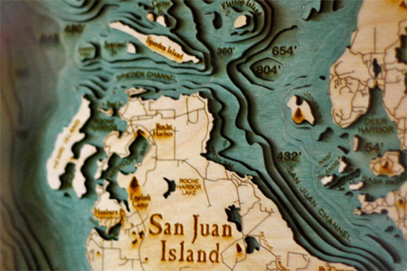 Laser-cut wood maps by Below the Boat
