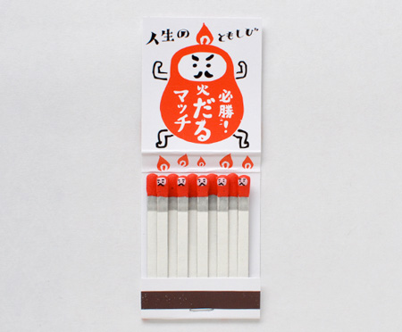 Individually hand-stamped kokeshi matches