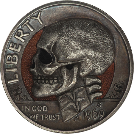 Hobo nickels carved from clad coins