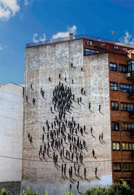 Figures congregate on a building in Spain