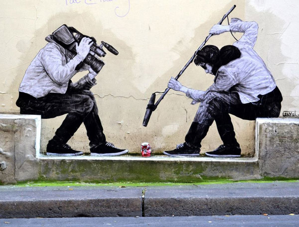 Humourous street art by Levalet in the street of the Paris