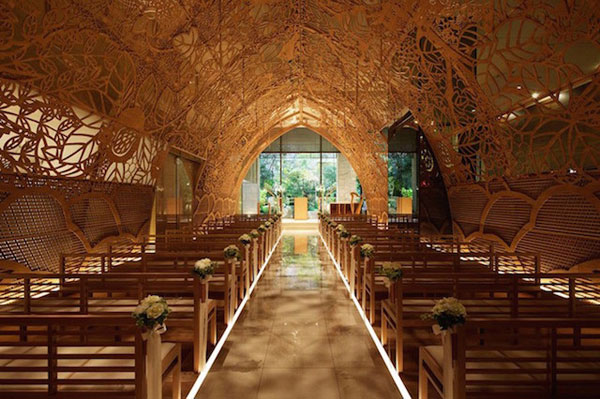 Power of flower: a wedding chapel made with 100 carved wood panels