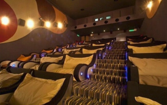 A movie theater with giant bean bags