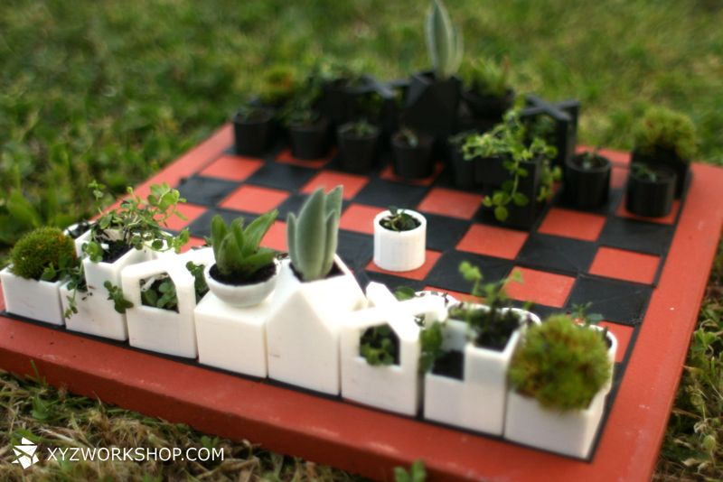 A chess board that uses 3D printed micro-planters as pieces