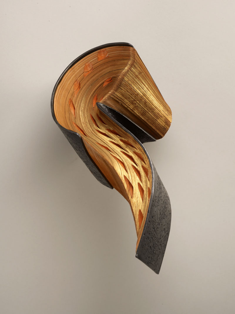 Stunning book sculptures shaped with metal