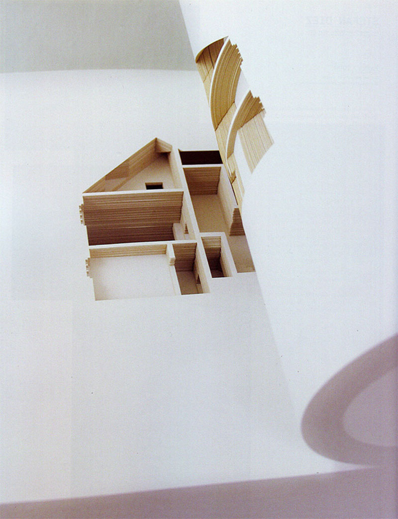 A concept art book that features a paper cutted house