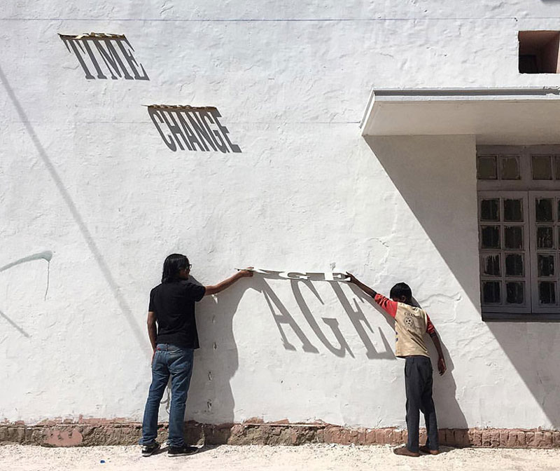 A typographic shadow graffiti that changes during the day